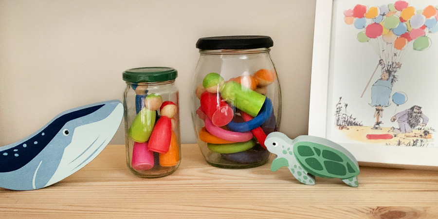 small toys in jars