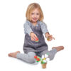 Girl holding strawberry and bee from flower pot
