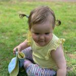 Child sitting on grass