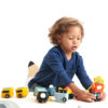 Child playing with robot and space race set