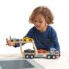 Boy loading car transporter