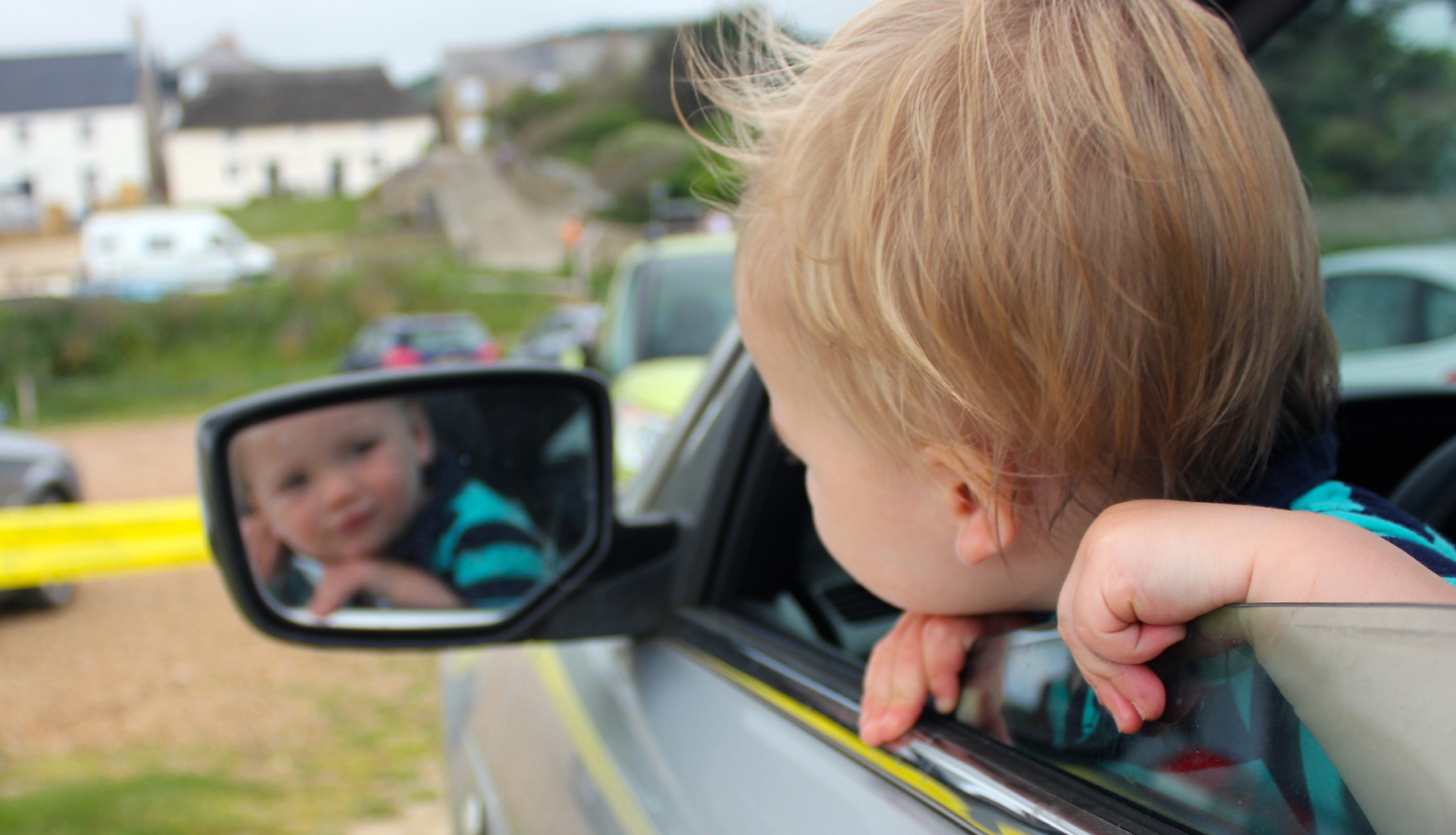 Boy looking out of car window