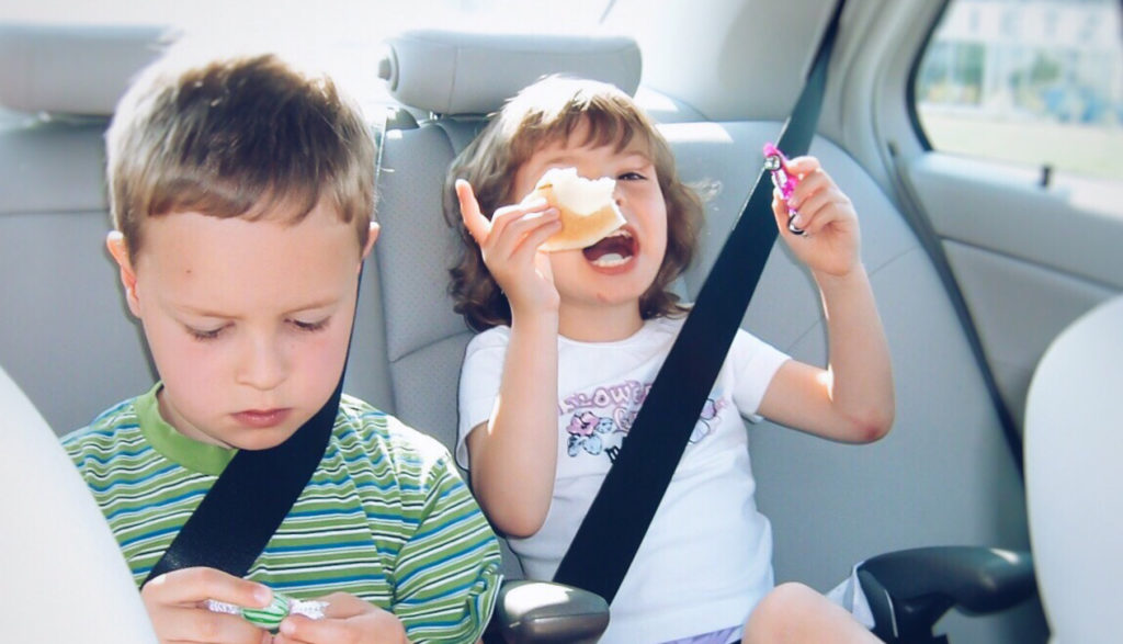 Children bored in the back of the car