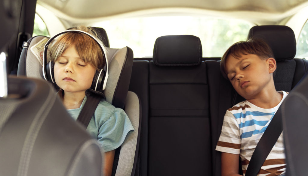 Children sleeping in the back of a car