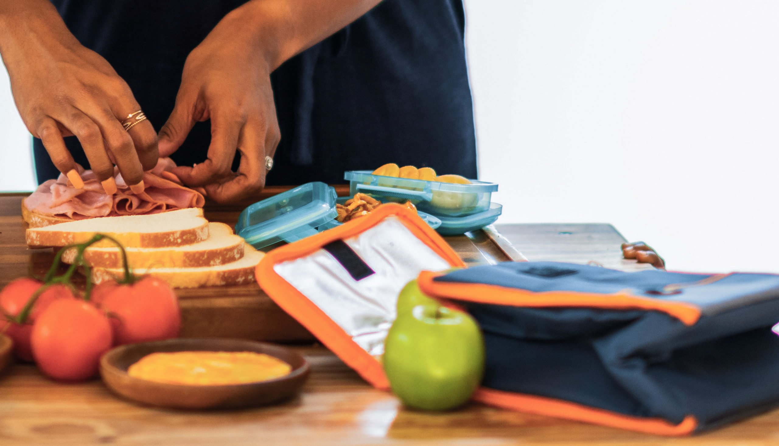 photo shows woman packing children's lunches
