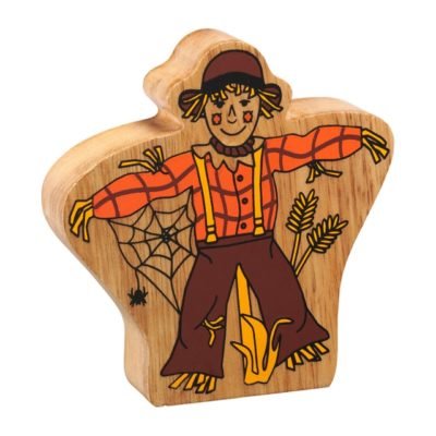 image shows a wooden scarecrow figure